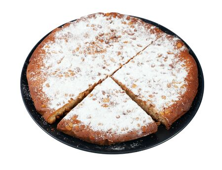 Italian Pine Nut Cake on black plate cut out on white