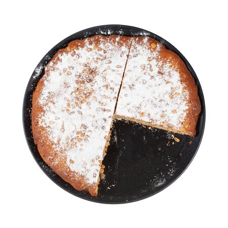 Top view of sliced Italian Pine Nut Cake on black plate isolated on white