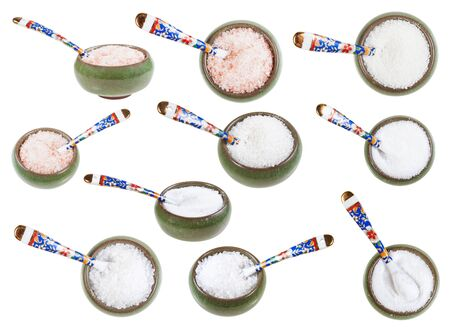 Set from ceramic salt cellar with spoon with various salts isolated on white