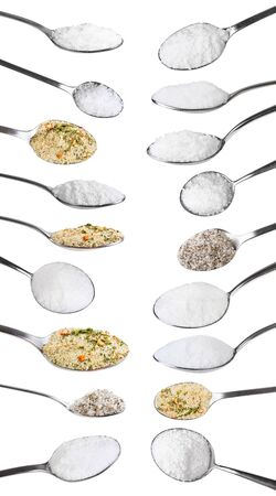 Set from steel spoons with various salts isolated on white