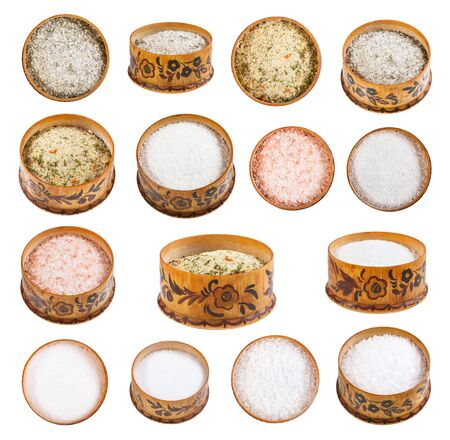 Collection from wooden salt cellar with various salts isolated on white