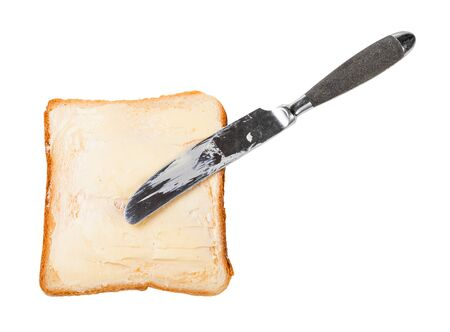 top view of knife and open sandwich with toast and butter (bread and butter) isolated on white background