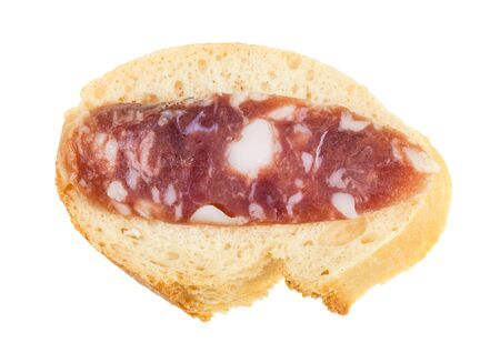 top view of open sandwich with fresh bread and slice of cured sausage isolated on white background