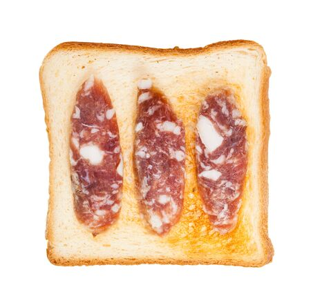 top view of open sandwich with toast and three slices of cured sausage isolated on white background Stok Fotoğraf