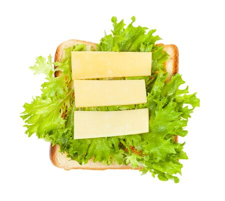 top view of open sandwich with toast and three slices of cheese and fresh green leaf lettuce isolated on white background