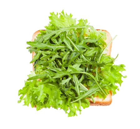 top view of open sandwich with toast and fresh greens isolated on white background