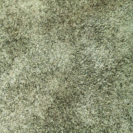 textured square background from dark olive green suede close up Stok Fotoğraf