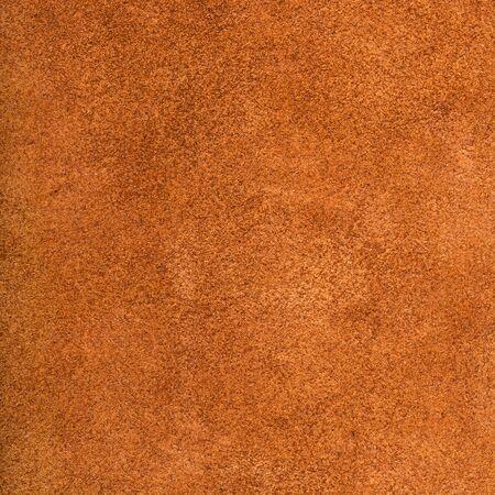 textured square background from dark orange suede close up