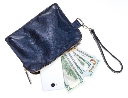 top view of open small blue leather wristlet purse bag with phone, credit cards and dollars isolated on white backgroun Banco de Imagens