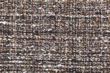 textile background - motley woven yarns of boucle fabric close up Banque d'images