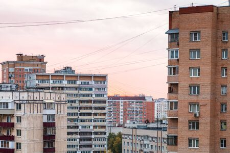 pink sunset sky over residential quarter in Moscow city in autumn evening Standard-Bild