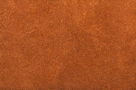 textured background from orange brown suede close up