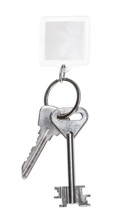steel keys on keyring with blank keychain isolated on white background