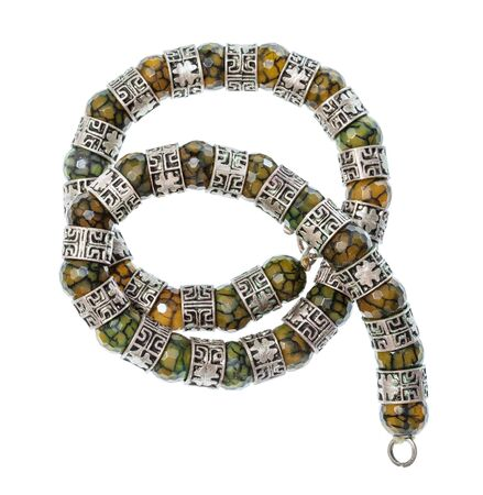 top view of antique arabic coiled necklace from faceted Jadeite gems and silver rings isolated on white background