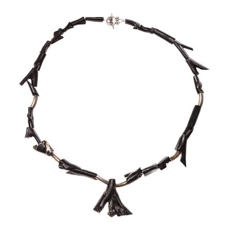 top view of necklace from polished black coral twigs isolated on white background