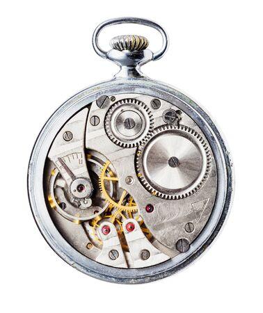 Vintage reloj de bolsillo mecánico sin tapa trasera aislado sobre fondo blanco.
