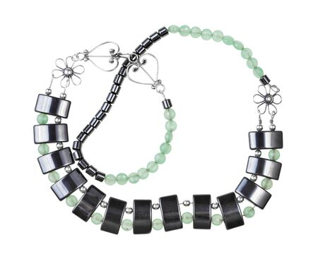 tangled hand crafted necklace from green jade, black hematite and silver beads isolated on white background