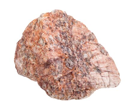 closeup of sample of natural mineral from geological collection - raw pink Granite rock isolated on white background