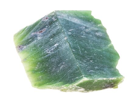 closeup of sample of natural mineral from geological collection - polished raw Nephrite (green jade) stone isolated on white background Stock Photo