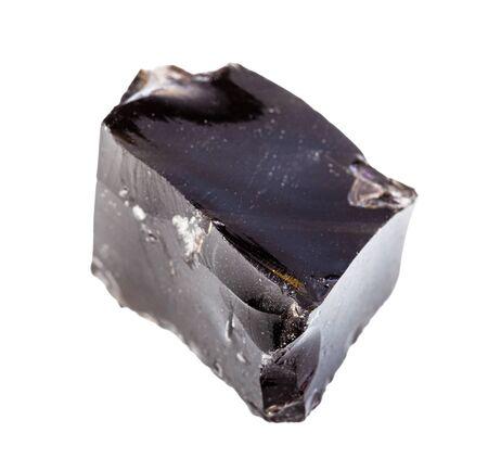 Primer plano de una muestra de mineral natural de la colección geológica - pieza afilada de roca de obsidiana (vidrio volcánico) en bruto aislada sobre fondo blanco Foto de archivo