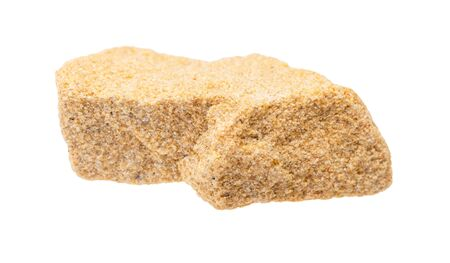 closeup of sample of natural mineral from geological collection - unpolished sandstone rock isolated on white background