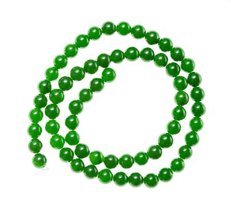 top view of spiral string of round beads from natural green nephrite gemstones isolated on white background