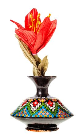 handmade artificial paper red flower in vintage arabian ceramic vase isolated on white background Banque d'images