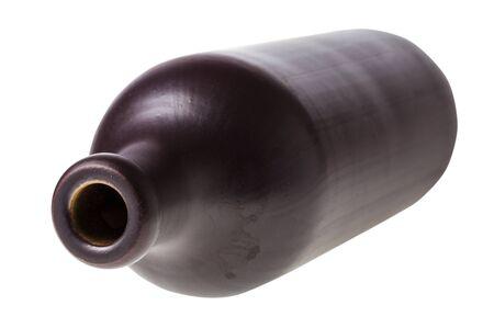 overturned black ceramic bottle isolated on white background