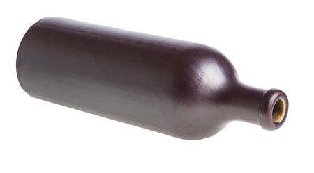 lying black ceramic bottle isolated on white background Imagens