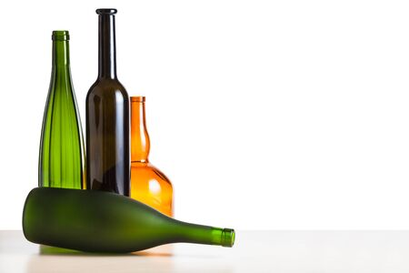 four various empty bottles on wooden table with cutout background