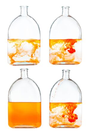 set of orange ink solutions in water in glass flask isolated on white background