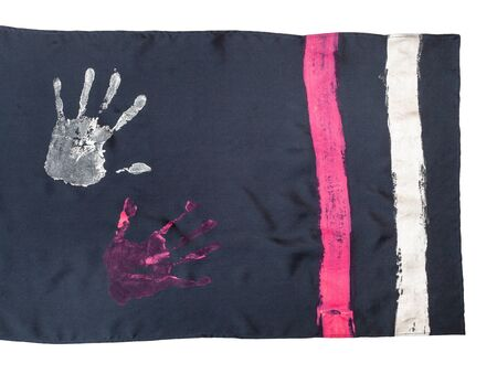 detail of handcrafted black silk scarf with handpainted handprints isolated on white background