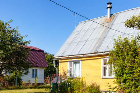 wooden blockhouses in village in Russia on sunny summer day