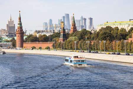 view of Kremlin with Moscow-city and skyscraper of Ministry of Foreign Affairs on background from Bolshoy Moskvoretsky Bridge of Moskva River on sunny autumn day