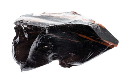 macro photography of sample of natural mineral from geological collection - raw Obsidian (volcanic glass) isolated on white background Standard-Bild