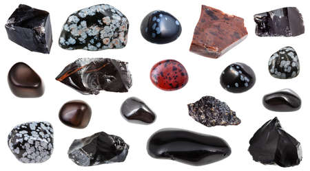 set of various Obsidian (volcanic glass) natural mineral gem stones and samples of rock isolated on white background