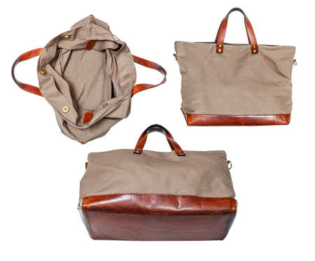 set of handcrafted travel handbag made from leather and canvas tarp isolated on white background