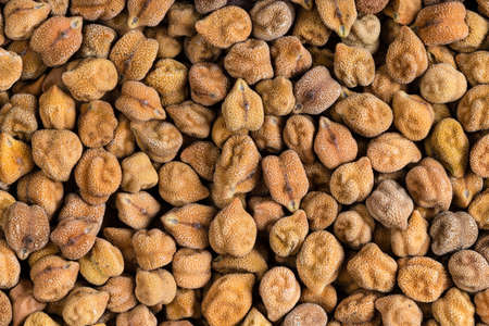 food background - many raw black chickpeas close up