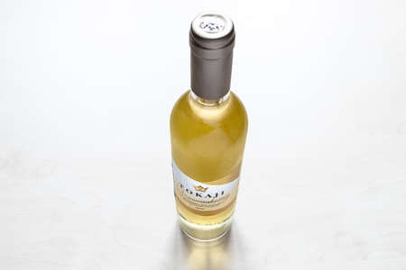 MOSCOW, RUSSIA - JUNE 10, 2021: closed bottle of hungarian sweet white wine Tokaji from Tokaji Kereskedohaz winery. Tokaj is considered as hungarikum, that is, a unique product of Hungary