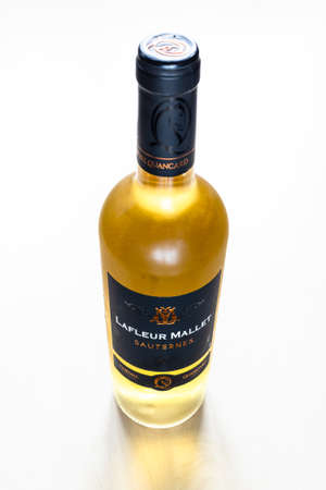 MOSCOW, RUSSIA - JUNE 10, 2021: closed bottle of French sweet wine Sauternes. Lafleur Mallet Sauternes from Cheval Quancard Winery from Bordeaux from Sauvignon Blanc, Semillon, Muscadelle grapes