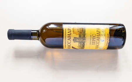 MOSCOW, RUSSIA - JUNE 10, 2021: bottle with aged fortified wine Massandra Sherry from Massandra crimean winery. The winery was founded by Knyaz Lev Golitsyn in 1894