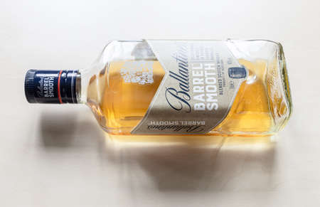 MOSCOW, RUSSIA - JUNE 10, 2021: open bottle of Ballantine's Barrel Smooth whiskey. Ballantine's Scotch whiskey was introduced 1827, today this brand belong to Pernod Ricard