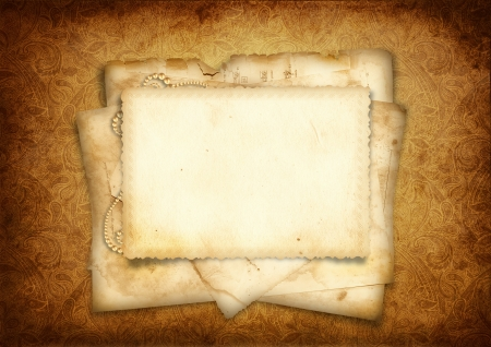photoalbum: Vintage background with stack of old postcard