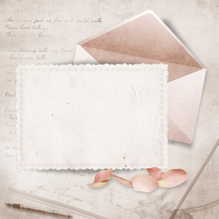 Beautiful card with envelope and rose petals  photo