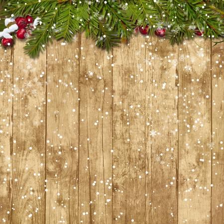クリスマスもみ木製の背景に赤い果実の小枝します。 写真素材