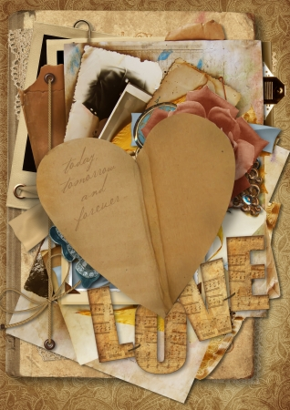 Vintage background with paper heart and old postcards and photos  Vintage background with paper heart and old postcards and photos  photo