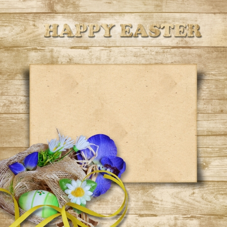 Easter card with nest with eggs on a wooden background  photo