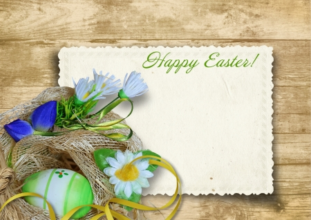 Ostern: Easter card with nest with eggs on a wooden background