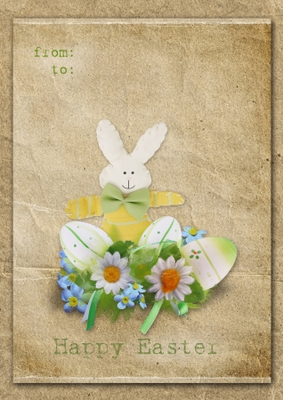 Happy Easter card with eggs and bunny on a vintage background  photo
