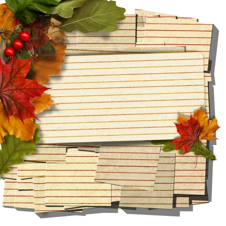 Vintage stack of cards with autumn leaves  photo